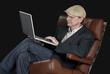 Man sitting indoors using laptop