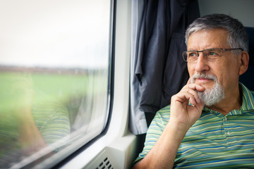 Senior man enjoying a train travel