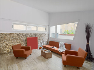 interior view of a modern living room with orange sofa
