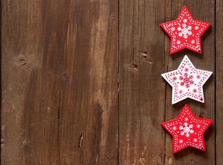 Christmas red and white stars on wooden background