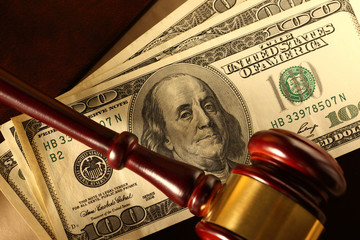Wooden gavel and dollar