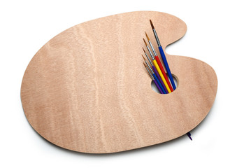 Wooden palette and paint brushes