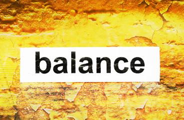 Balance text on grunge background