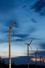 old wind turbine on sunset