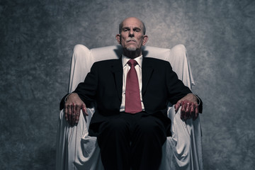Corrupt businessman with bloody hands sitting in white chair. Gr