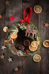 Christmas wreath on the wood with stars