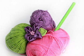 knitting accessories - three skeins on white background