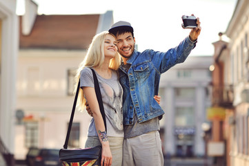 Couple taking self portrait photos with old camera
