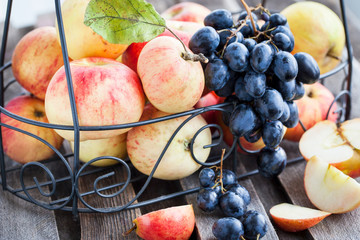 Fresh red apples and dark grape
