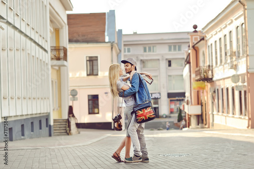 canvas print picture Young couple in love outdoor. Sensual outdoor portrait of young