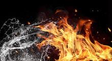 "Постер, картина, фотообои ""Fire and water elements on black background"""