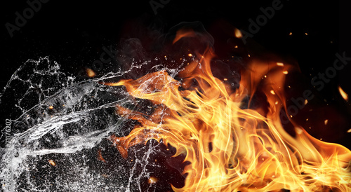 canvas print picture Fire and water elements on black background