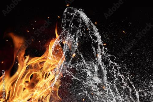 Leinwandbild Motiv Fire and water elements on black background