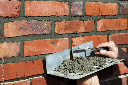 Jointing exposed brickwork - 71177269