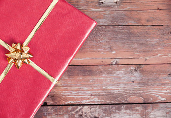 Red gift box on wooden background