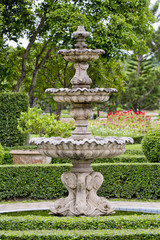 A large fountain outside with Thai style Sculpture