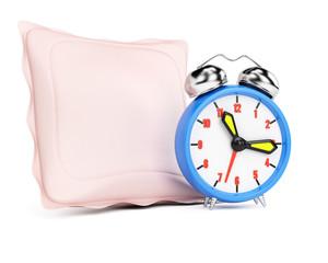 Alarm clock and pillow