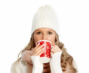 Young woman drinking hot tea.