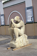 Sculpture of a man playing a flute