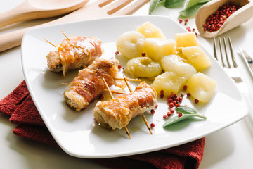 Bacon rolls, chicken, cheese with potatoes and onions