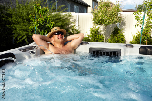 canvas print picture Man having massage in  hot tub spa.