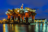 Oil Rig in the shipyard for maintenance at night.