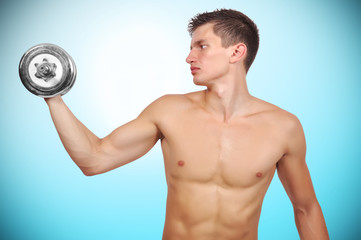 Guy holding dumbbell