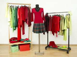 Wardrobe with complementary colors red and green plaid clothes.