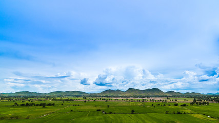 Beautiful cloud and blue sky over green field