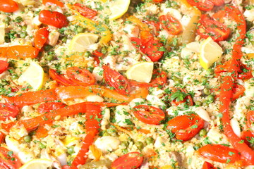 background of Valencian paella with rice and tomato