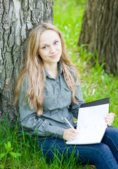 girl preparing for exams in nature