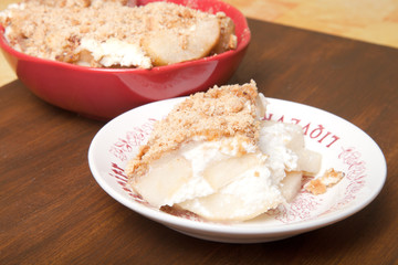 Baked pear with honey, cinnamon, brown sugar, ricotta cheese and