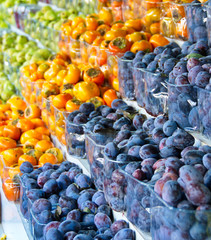 Israel market produce: plums and persimmon