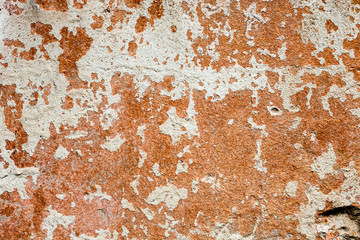 Concrete surface with the remains of whitewash and orange paint