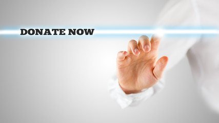Man in White Pointing Glowing Donate Now Texts