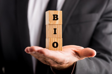 Man holding wooden blocks with the word Bio