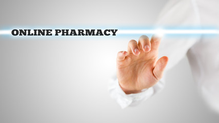 Man activating an online pharmacy search bar