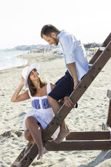 Smiling love young couple portrait at beautiful summer beach