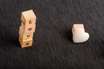 Letter Blocks Spelling LOVE Beside White Heart