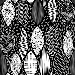 Seamless monochrome pattern with  abstract leaves on a black bac