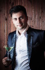 barman with  glass on a wooden background