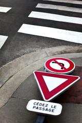 Traffic sign dropped on a sidewalk