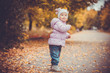 happy playful baby in the autumn park