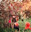 little girl in halloween costume with jack pumpkin