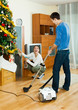 Happy man and woman doing housework