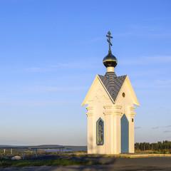 Orthodox chapel on blue sky background