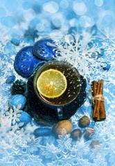 Christmas tea with lemon and decorations