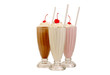 canvas print picture - Milk shakes isolated on white