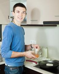 Handsome guy cooking frying squid