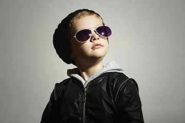 Fashionable little boy in sunglasses.Child.Winter Kids fashion